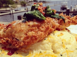 Fried grouper topped with spinach and bacon over smoked Gouda grits resting in a broccoli and cheese sauce! #lunchtime #fishhousepensacola #yum #foodporn #seafood #friedfridays #tgif