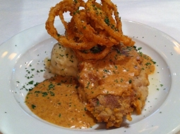 Country fried ribeye over mashed potatoes topped with gravy and fried onion rings #goodfriday #joinus #jacksonsrestaurant #todayslunchfeature #yum #downtownpcola