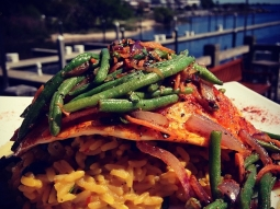 Blackened pompano topped with sautéed green beans, carrots, and onions over a black bean and scallion rice pilaf. #lunch #fishhousepensacola #goodeats #seafood #GulfToTable