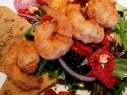 Cracker fried shrimp over mixed greens with cucumber, onion, sun dried tomato, and feta finished with a lemon vinaigrette. #fishhousepensacola #pensacola #florida #upsideofflorida #shrimp #salad