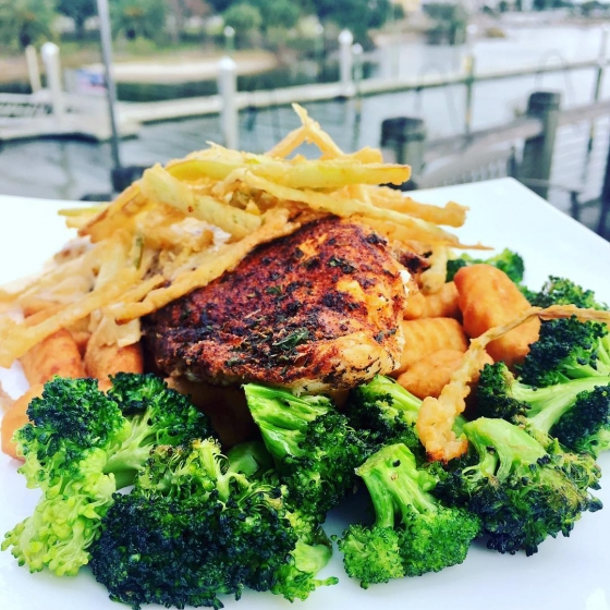 Today's special: Blackened redfish over fried potato gnocchi with garlic roasted broccoli topped with lobster fennel cream sauce!