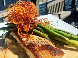 It's a perfect day in paradise! We love our backyard ? Enjoy this sunny day with lunch on Pensacola Bay!  Today's fish special: Blackened mahi over bacon and cheddarjack cheese mashed potatoes served with grilled asparagus and finished with blackened butter sauce and sweet potato hay!