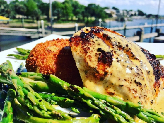 Start off the week with us! Today's fish special: Blackened redfish over bacon and Gouda grit cake served with grilled asparagus with blackened butter sauce!