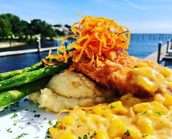 It's finally Friday!!!!! Let's eat! Kick off the weekend with us. Today's lunch special is ?Chicken fried mahi over Gouda cheese grits served with grilled asparagus!