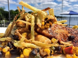 Come see us for lunch! Today's special: ?Blackened mahi mahi served over a crab mash and a black bean corn salsa finished with crispy leak hay and blackened butter sauce! ?