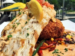 Lunch lunch lunch! Happy Friday, let's eat! ?Grilled mahi over roasted red pepper cake potato cake with sautéed corn, bell peppers, and onions resting in blackened butter sauce with chipotle remoulade and pico de gallo! ?