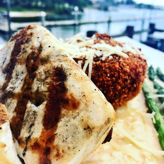 ?Happy Friday! Come see us for lunch! Grilled mahi over a Parmesan mushroom risotto cake grilled asparagus and lobster fennel ? ?