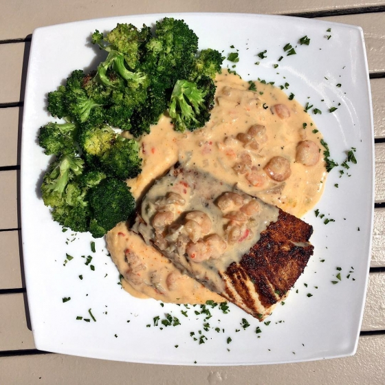 Lunch time! Today's special: Blackened mahi over pimento cheese rice grits served with garlic roasted broccoli and finished with shrimp and crab cheese sauce. ?