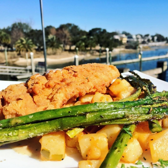 HAPPY FRIDAY! Come eat with us! Today's lunch special: ?Chicken fried mahi over Cajun hash potatoes, served with grilled asparagus, and finished with blackened butter sauce! ?