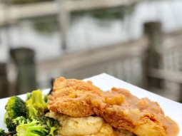 Time to eat! Come see us for lunch! Chicken fried mahi over gouda cheese grits served with garlic roasted broccoli and finished with shrimp etouffee and green onions. #downtownpensacola #fishhousepensacola #upsideofflorida