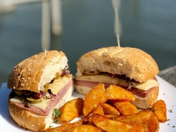 It's a beautiful day on the water! Join us for our lunch special today and choose between a muffaletta sandwich or french dip and your choice of a side! #downtownpensacola #fishhousepensacola #upsideofflorida