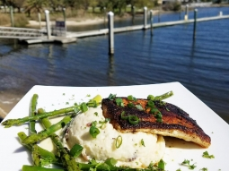 Take a break from the office - let's do lunch! Today's special: blackened mahi over celery root mashed potatoes served with grilled asparagus and finished with lemon beurre blanc and green onions. Yum! #fishhousepensacola #downtownpensacola #upsideofflorida