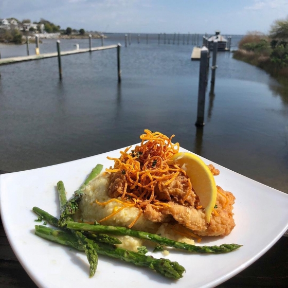 Who's hungry? Today's special is chicken fried tripletail over gouda cheese grits served with grilled asparagus and finished with tangy meunière sauce and sweet potato hay. #fishhousepensacola #downtownpensacola #upsideofflorida
