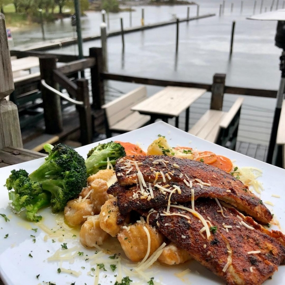 Come eat with us! Today's special is blackened mahi over fried potato gnocchi tossed with house-made alfredo sauce served with garlic roasted California vegetable medley and finished with grated parmesan cheese. #fishhousepensacola #downtownpensacola #upsideofflorida
