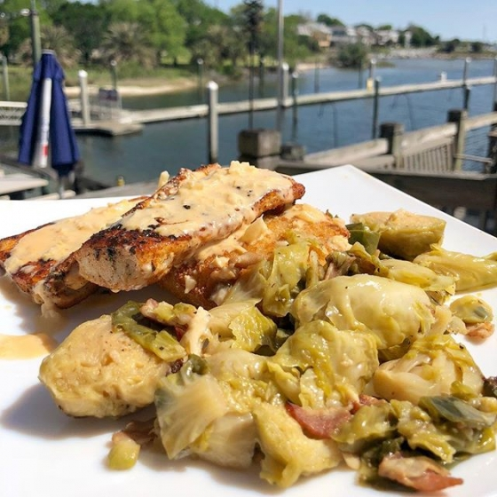 Join us at the Fish House for lunch today! Our special is blackened mahi over a bacon gouda cheese grit cake served with braised brussel sprouts and finished with lobster fennel sauce. Yum! #fishhousepensacola #downtownpensacola #upsideofflorida