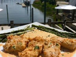 Happy Friday! Start your weekend with lunch at the Fish House! Our special today is chicken fried mahi over cajun crawfish polenta served with grilled asparagus and finished with blackened butter. #fishhousepensacola #downtownpensacola #upsideofflorida