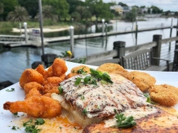 Grab your friends and head down to the Fish House for lunch! Our special today is blackened mahi over caramelized onion and cheddar jack cheese mashed potatoes served with fried zucchini and buffalo cauliflower, finished with blackened butter sauce and green onion. Delicious!  #fishhousepensacola #downtownpensacola #upsideofflorida