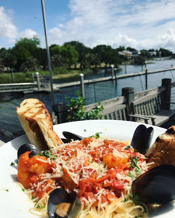 It's great day for lunch on the water! Today's special: Seafood bolognese over capellini pasta with crab, mussels, shrimp, and finished with freshly grated Parmesan cheese