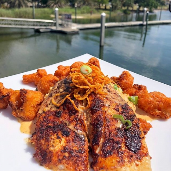 Start your weekend with lunch at the Fish House! Today's special is blackened flounder over acadia grits served with fried buffalo cauliflower and finished with blackened butter sauce and sweet potato hay. #fishhousepensacola #downtownpensacola #upsideofflorida