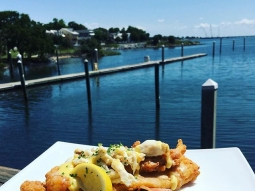 Let's do lunch! Today we're having Flounder Oscar Almandine: Cracker fried flounder topped with crab meat and meunière sauce, served with a side of grilled vegetables