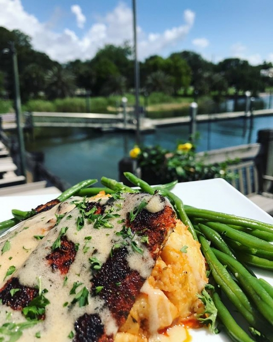 Lunch is served! Today's special: Blackened mahi over Acadia grits, served with a side of sautéed green beans, and finished with meunière sauce