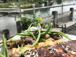 Join us for lunch at the Fish House today! Our daily special is blackened amberjack over lightly fried potato gnocchi tossed in lobster fennel cream sauce served with sautéed green beans and mushroom.  #fishhousepensacola #downtownpensacola #upsideofflorida