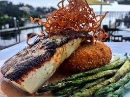 Monday's are better with lunch at our house! Today's lunch special: ?Blackened mahi over bacon and Gouda cheese grit cake served with grilled asparagus and finished with sweet potato hay and blackened butter sauce.