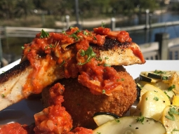 It's lunch time! Today's special is lightly blackened amber jack served with a fried polenta cake and lemon pepper squash medley, topped with red pepper and artichoke marinara.#fishhousepensacola #downtownpensacola #upsideofflorida