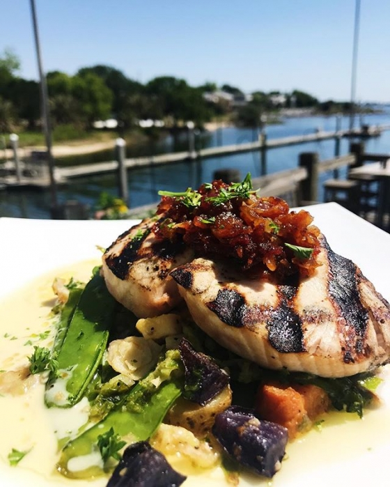 It's a perfect day for lunch on the deck! Today's special: Grilled swordfish over purple and seeet potatoes, Brussels sprouts, arugula, and zipper peas. Finished with a morné sauce and bacon jam