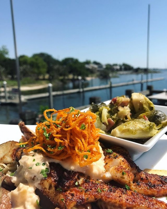 It's lunch time! Today's special: Blackened flounder over Parmesan roasted potatoes, served with braised Brussels sprouts, finished with lobster fennel sauce and sweet potato hay