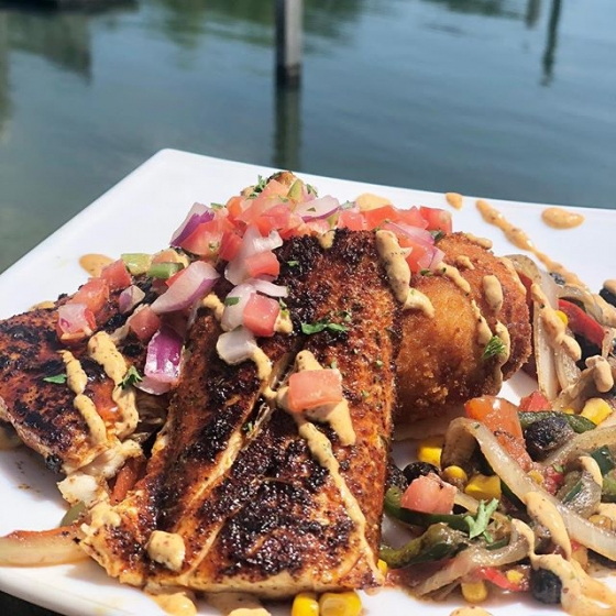 Happy Friday! Join us for lunch on the deck today. Our special is blackened mahi over a bacon and gouda grit cake with a sauté of southwest vegetables finished with pico de gallo and chipotle remoulade. #fishhousepensacola #downtownpensacola #upsideofflorida