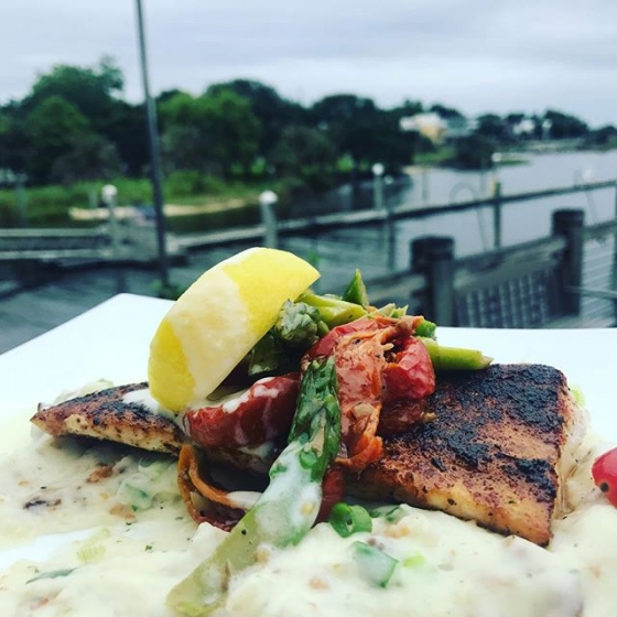Happy Tuesday! Today's special is blackened mahi over loaded mashed potatoes, topped with roasted asparagus and tomato salad, and finished with beurre blanc sauce